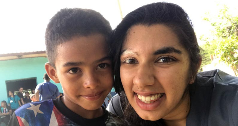 Akshita Taneja (MS/Biomed '19) smiles with a Honduran child during a medical mission trip.
