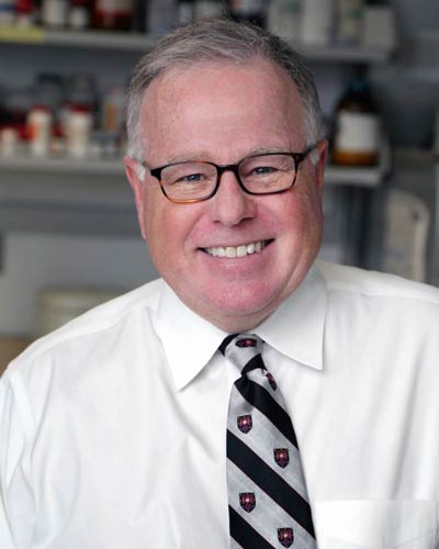 Headshot photograph of William Douglas Figg, Sr., PharmD, MBA in a pharmacy lab
