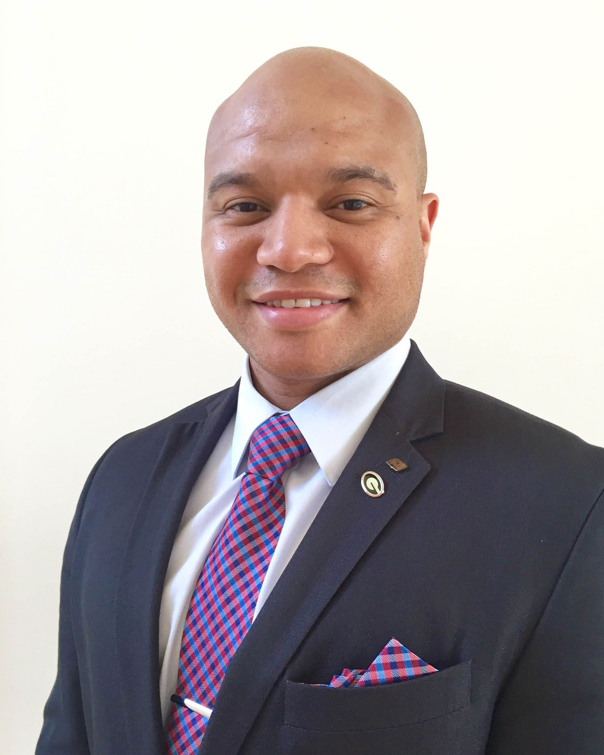 Professional headshot photograph Abdul Walters wearing a suit