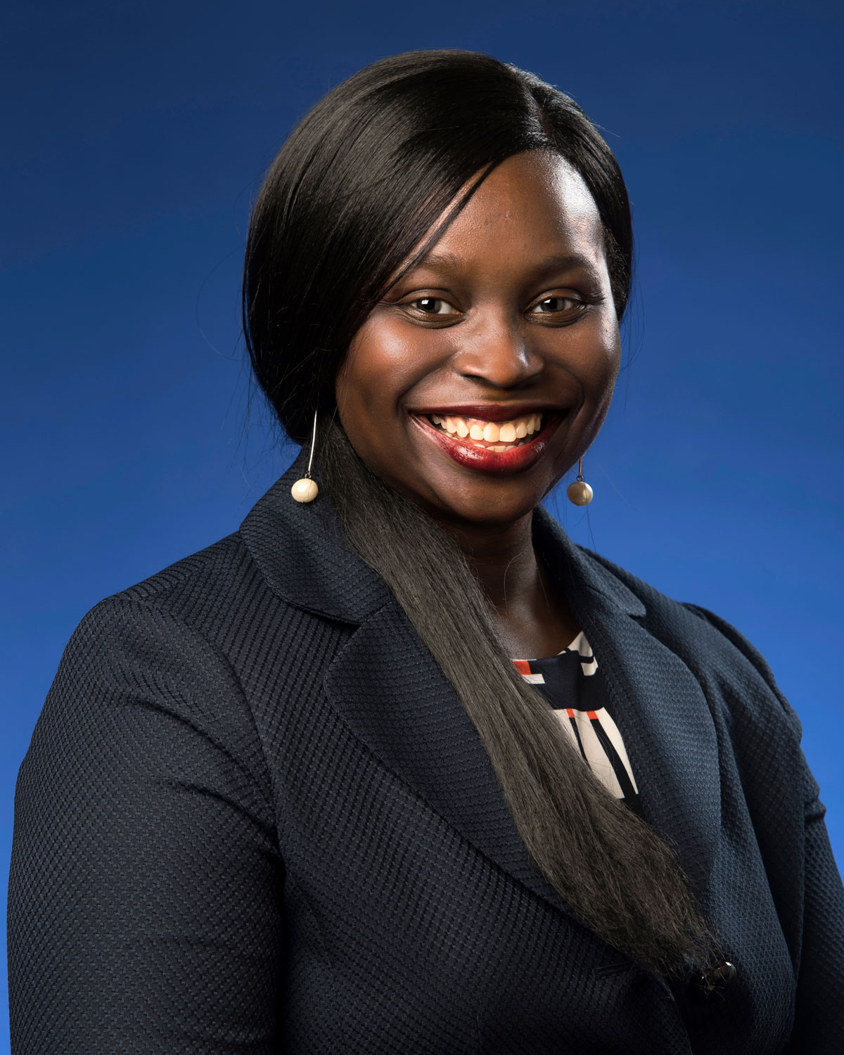 Professional headshot photograph of Edo-Abasi McGee, PharmD, BCPS.