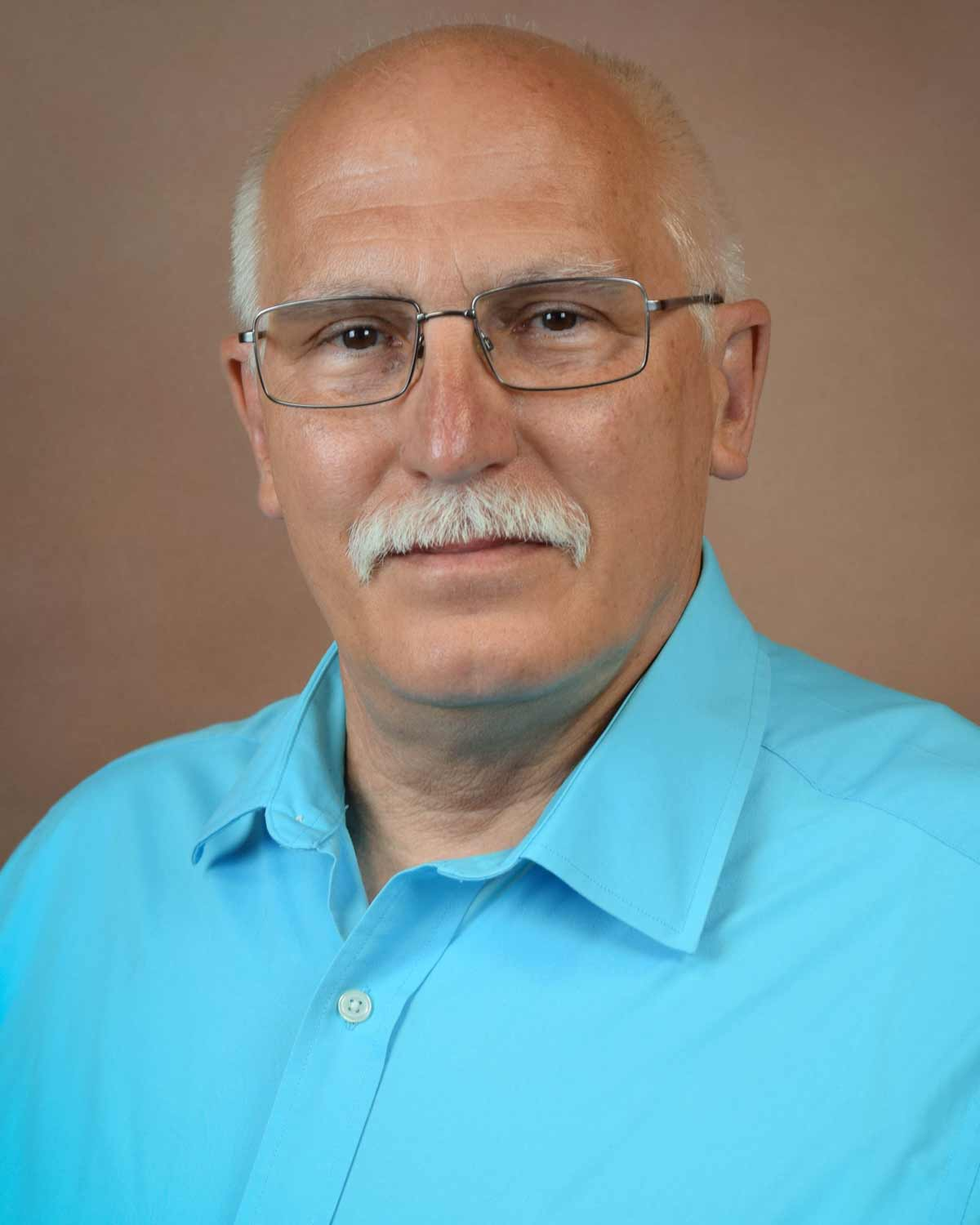 Professional headshot photograph of George Fredrick, MD