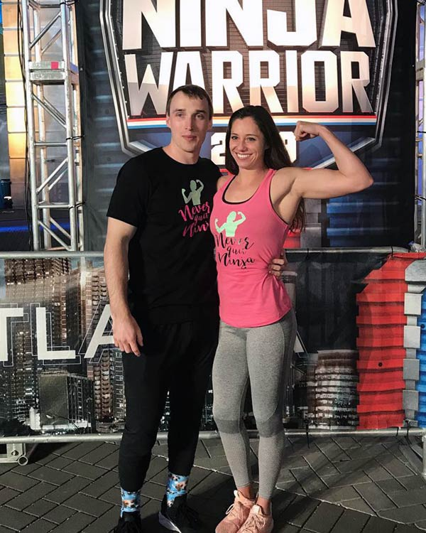 Alyssa Varsalona poses with another contestant under the American Ninja Warrior sign