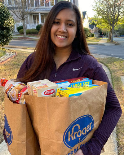 Hiral Patel (DO '22) delivering groceries in a Gwinnett County neighborhood.