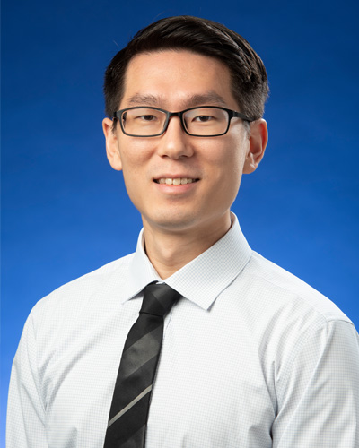 Professional headshot photograph of fourth year pharmacy Jonathan Park wearing a shirt and tie