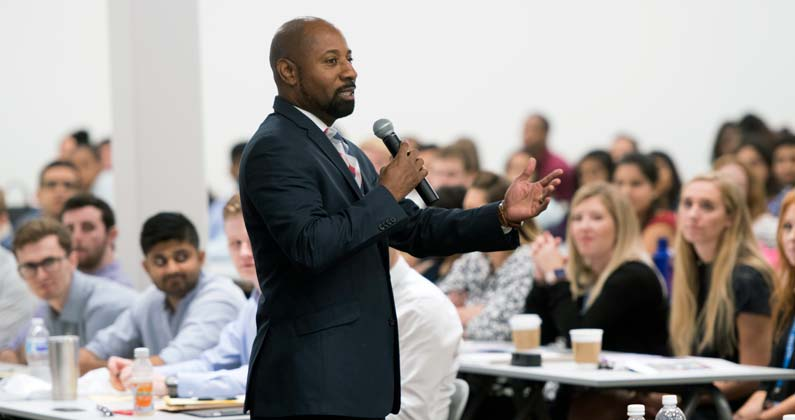 Craig Brown, JD, MBA, GA-PCOM Director of Admissions, addresses prospective students during an open house event.