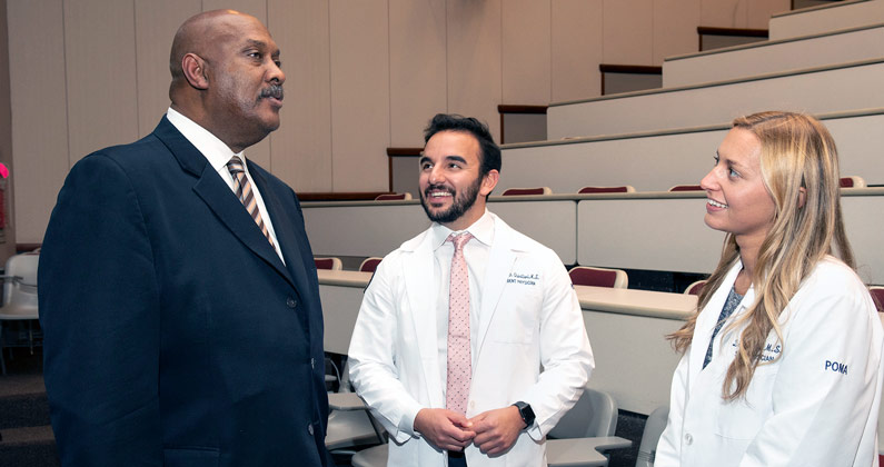 PCOM medical students speak with Congressman Dwight Evans (D-PA-03) in a lecture hall