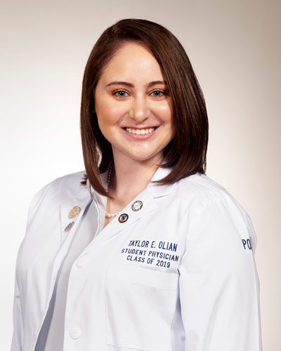 Professional headshot photograph of Taylor E. Olian, DO '19, wearing her student physician white coat