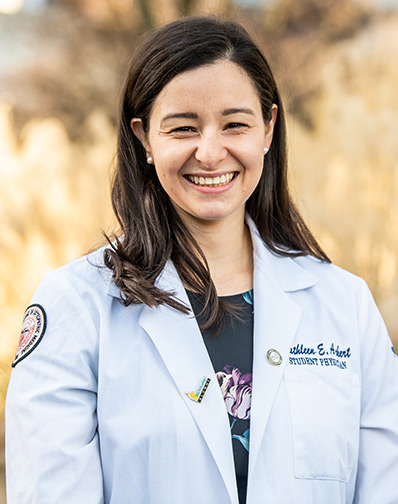 Professional headshot photograph of Kathleen Ackert, DO '20, wearing her student physician white coat