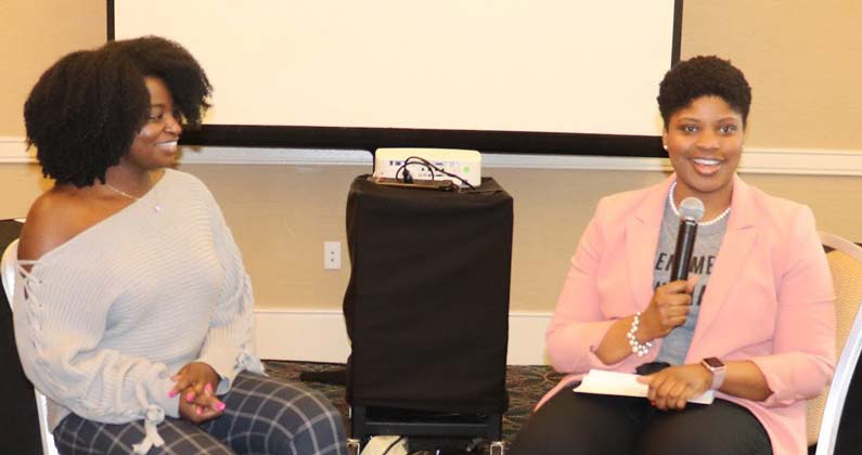 PCOM medical student Alicia Williams (DO '22) speaks into a microphone alongside her guest, Magdala Chery, DO.