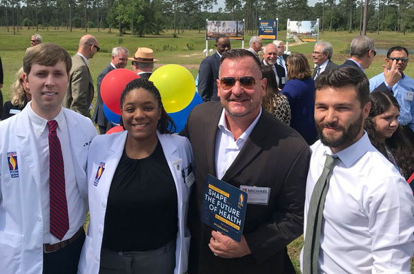 Dr. Michael Sampson (second from left) is pictured at the PCOM South Georgia groundbreaking with several GA-PCOM medical students.
